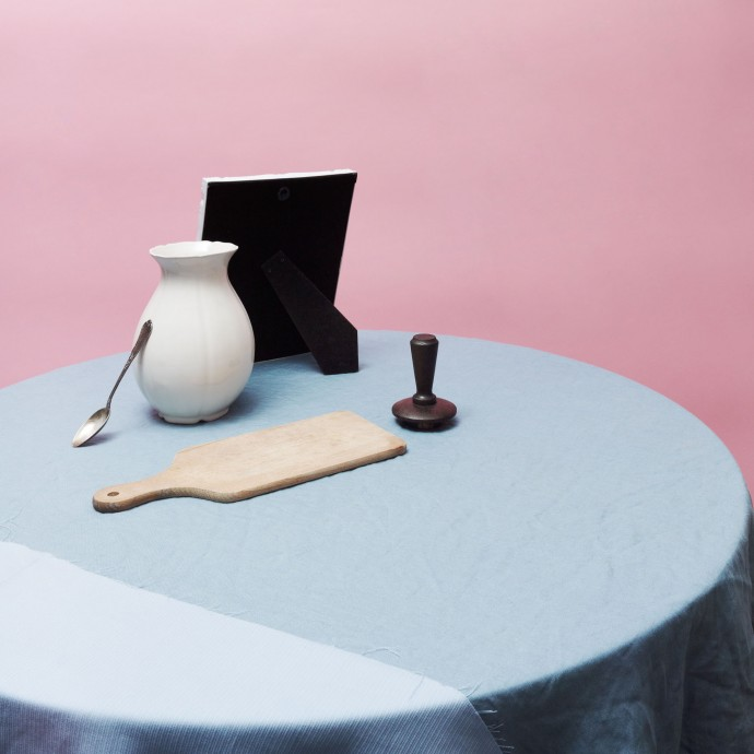 Table composition with vase and frame